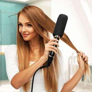 lisseur cheveux - femme salle de bain